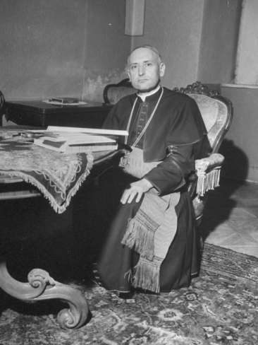 cardinal-josef-mindszenty-sitting-at-a-table_i-G-60-6023-B1ZB100Z