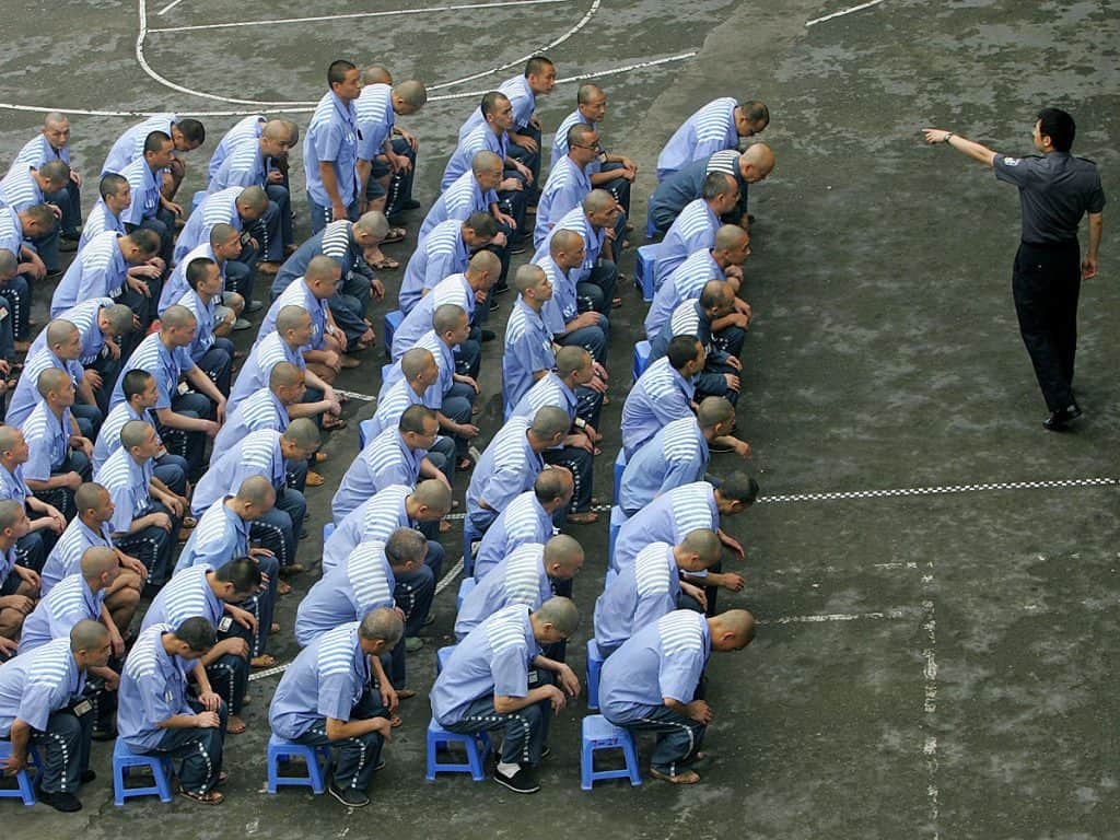 prisoners-are-subjected-to-the-big-hang-and-the-death-bed-at-chinas-notorious-re-education-labor-camps