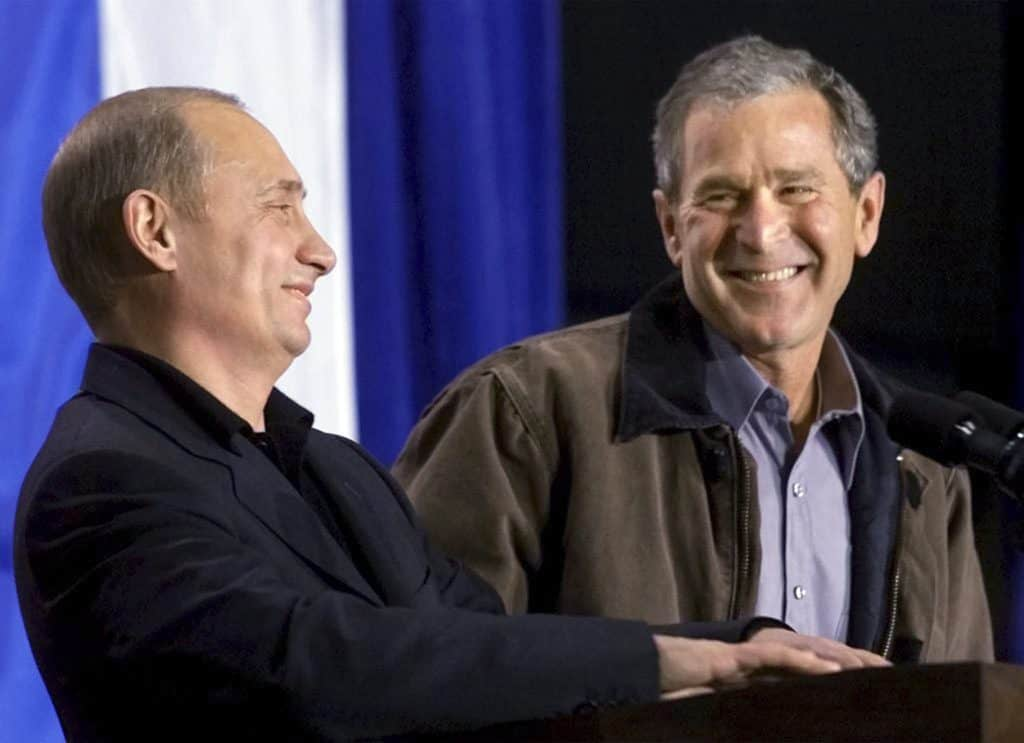 File photo of U.S. President Bush laughing with Russian President Putin in Crawford, Texas