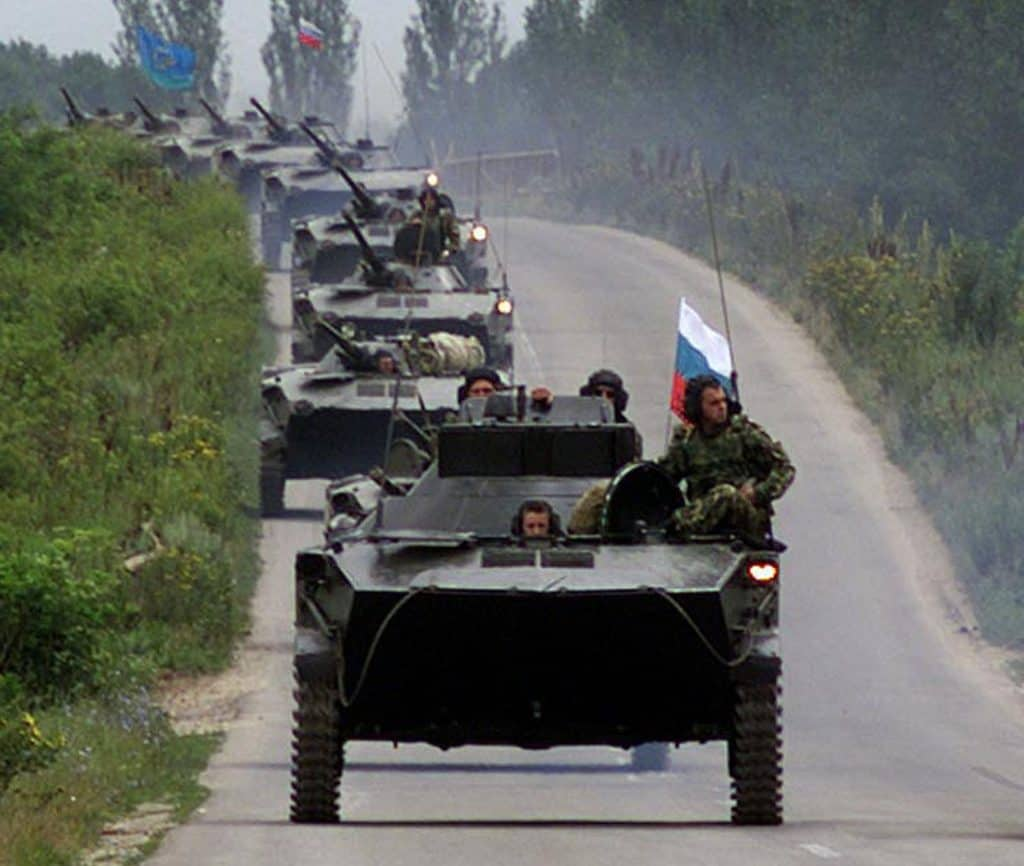 A Russian convoy of armoured vehicles drives into the outskirts of Pristina July 15. The Russian con..