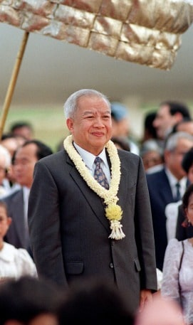 Prince Norodom Sihanouk listens to the national an
