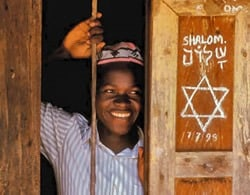 Child with Shalom sign- BHC