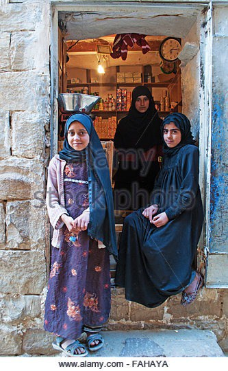 a-yemeni-woman-and-two-girls-in-the-village-of-thula-fortified-city-fahaya