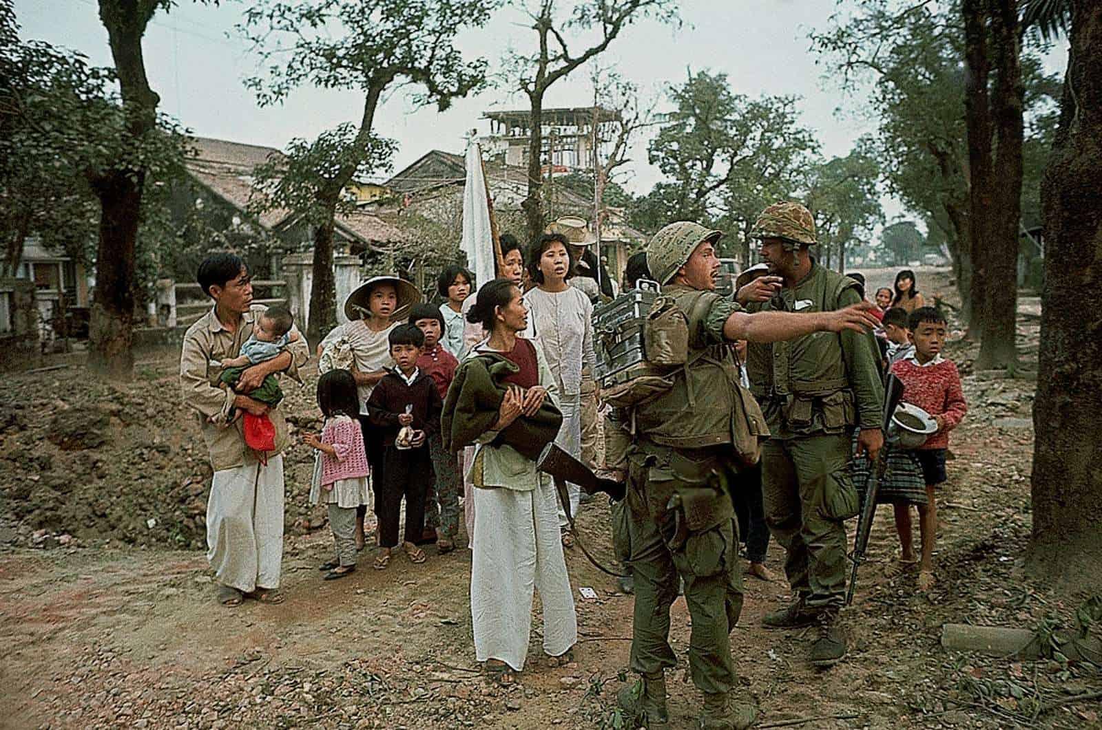 Civilians with Marines during Battle of Hue (1968) Kyoichi Sawada   flickr.com