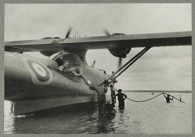Tamil coolies helping to launch a Catalina flying boat down the slipway for a patrol mission in the Far East (1941/1942) United States. Office for Emergency Management | Library of Congress