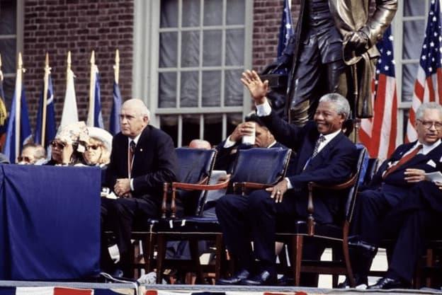 F.W. de Klerk, left, the last president of apartheid-era South Africa, and Nelson Mandela, his successor, wait to speak in Philadelphia, Pennsylvania. (1993), Carol M. Highsmith, Library of Congress.