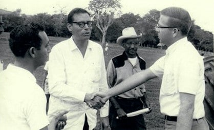 Almaguer as a Peace Corps volunteer greeting Prime Minister of British Honduras (Belize) George Price (1968) | Courtesy of Frank Almaguer